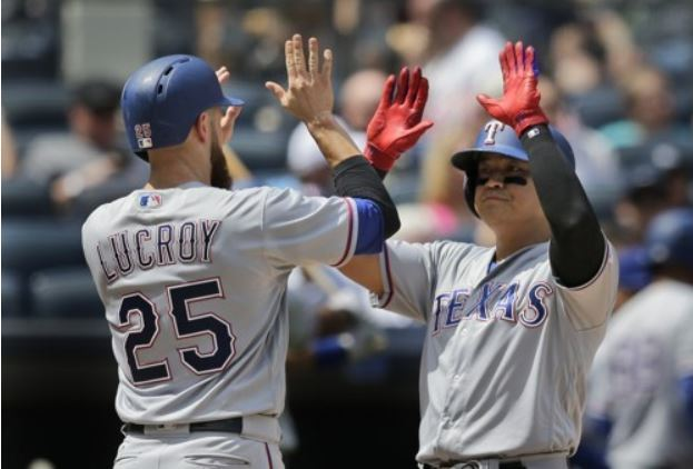 Choo Shin-soo of the Texas Rangers (R) celebrates his three-run home run with Jonathan Lucroy in the second inning of a Major League Baseball game against the New York Yankees at Yankee Stadium in New York on June 25, 2017. (Yonhap-AP)