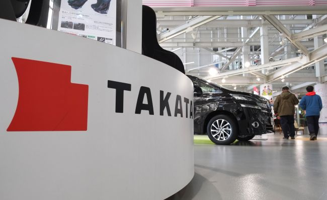 This photo shows the logo of Japanese auto parts maker Takata displayed at a car showroom in Tokyo. AFP-Yonhap
