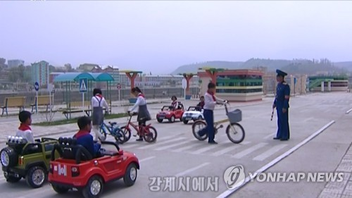 This still image, captured from video footage from North Korea`s Korean Central TV on May 14, shows children taking part in traffic safety education at a traffic park in the city of Kanggye in North Korea`s northern Jagang Province. (For Use Only in the Republic of Korea. No Redistribution) (Yonhap)