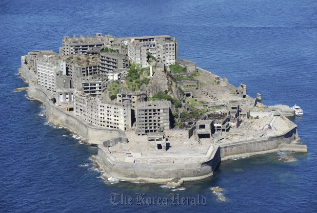 """Hashima undersea coal mine off Nagasaki, known as """"Battleship Island,"""" one of the 23 properties of """"Japan's Meiji Industrial Revolution"""" which were newly listed as World Heritage sites. (Yonhap)"""
