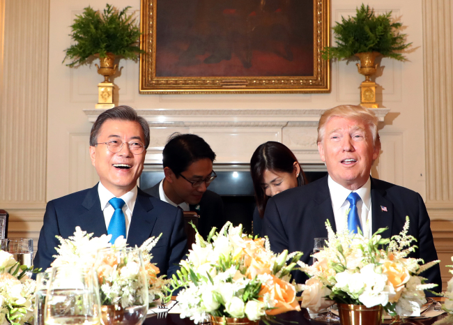President Moon Jae-in (left) meets with US President Donald Trump at the White House in Washington, DC on Thursday. (Yonhap)