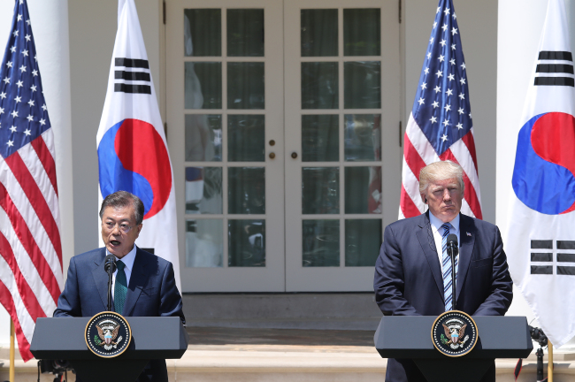 President Moon Jae-in (left) speaks during a joint news conference with US President Donald Trump after their summit at the White House in Washington on Friday. (Yonhap)