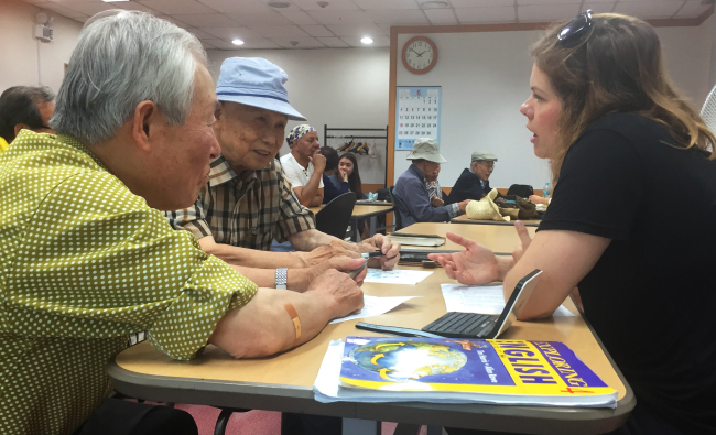 German volunteer Steffi Kuehnel asks senior citizens about their lives. (Aparna Balakumar).