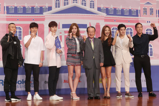 "From left: Rado and Choi Kyu-sung of Black Eyed Pilseung, Kim Hee-chul, Stephanie, Lee Soon-jae, Bada, Jang Jin-young and sports trainer Yun Tae-shik poses for a photo during a press conference for ""Idol School,"" Wednesday in Seoul. (Yonhap)"