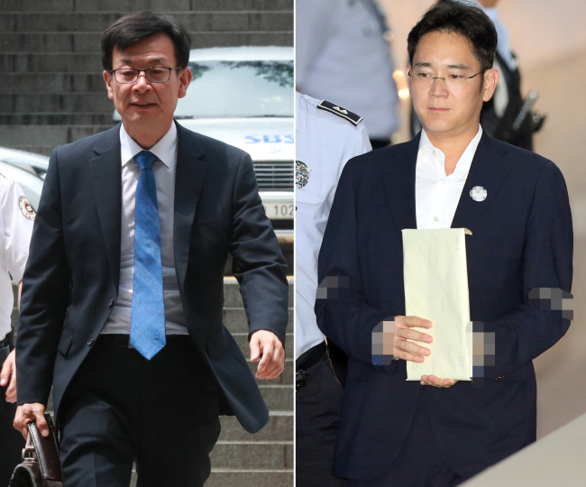 Chief of the Fair Trade Commission Kim Sang-jo (left) and Samsung Electronics vice-Chairman Lee Jae-yong are escorted to the Seoul's courtroom. (Yonhap)