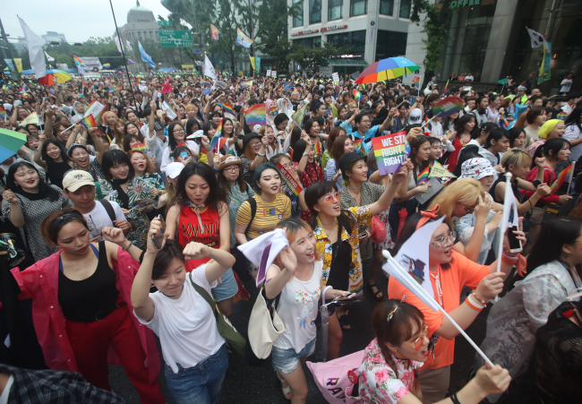 Sexual minorities and their advocates march through central Seoul in the pride parade Saturday. (Yonhap)