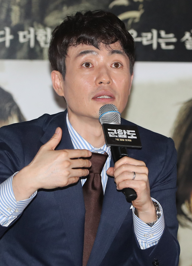 """Director Ryoo Seung-wan speaks at a press call for the film """"The Battleship Island"""" held at CGV Yongsan on Wednesday. (Yonhap)"""