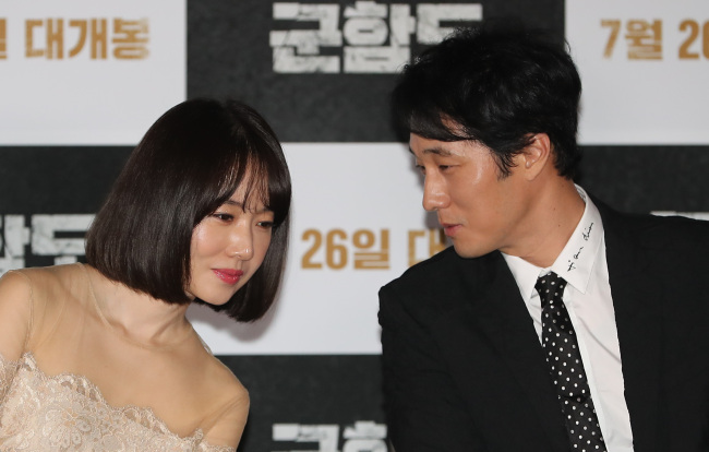 """Lee Jung-hyun (left) and So Ji-sub attend a press call for the film """"The Battleship Island"""" held at CGV Yongsan on Wednesday. (Yonhap)"""