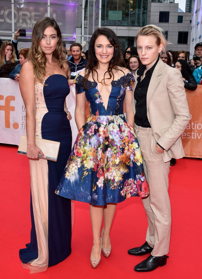 """Director April Mullen (center) and lead actresses Natalie Krill (left) and Erika Linder appear on the red carpet for the premiere of """"Below Her Mouth"""" at the Toronto International Film Festival in September. (April Mullen)"""