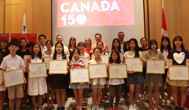 Student winners of the Canadian Embassy's creative writing contest, Canadian authors and diplomats pose at an awards ceremony at the embassy in Seoul on Saturday. (Canadian Embassy)