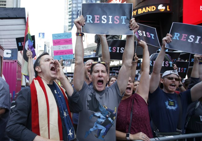 People protest US President Donald Trump announcement that transgender people will not be allowed to serve in the US military in Times Square, New York, Wednesday. EPA-Yonhap