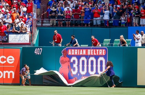 A sign commemorating Adrian Beltre's 3000th hit is unveiled on the right-field wall of the Texas Rangers' home stadium, Global Life Park. (Yonhap)