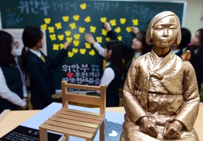"A miniature ""comfort woman"" statue inside a high school classroom in Incheon. (Okyrun Girls' High School)"