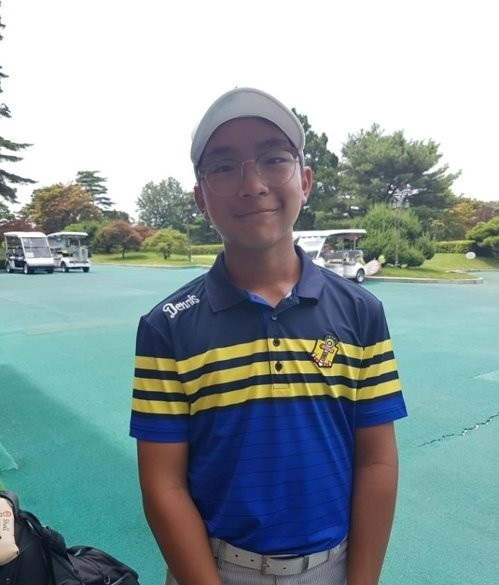 Choi Kang-jun, son of PGA Tour veteran Choi Kyoung-ju poses for a photo after completing the second round of the Korea National Junior Championship at Lake Hills Yongin Country Club in Yongin, Gyeonggi Province, on Aug. 2, 2017. (Yonhap)