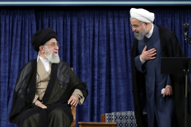 Iranian President Hasan Rouhani (R) speaks with supreme leader Ayatollah Ali Khamenei during his swearing-in on August 3, 2017 (AFP)