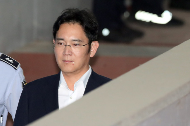 Samsung's heir, set to spend 12 years behind bars