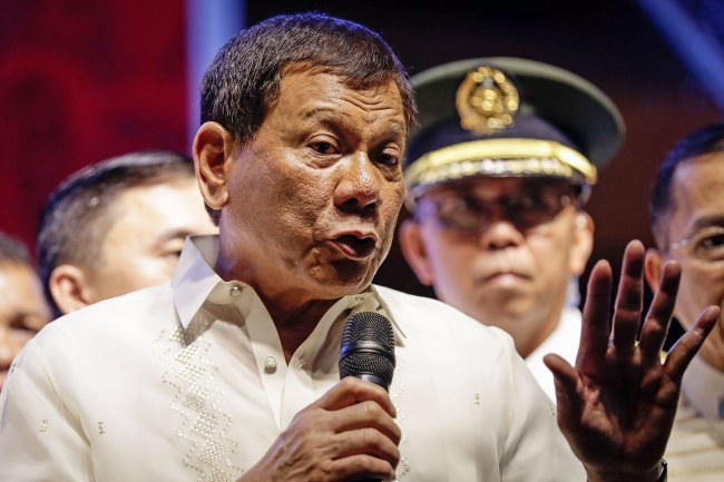 Philippine President Rodrigo Duterte speaks to protesters in Quezon City, Philippines 24 July 2017. Duterte spoke to protesters after delivering his second State of the Nation Address. Several thousand left-wing protesters marched on 24 July 2017, to the House of Representatives to demand Duterte deliver on promises made in his first state of the nation speech in 2016. (EPA/MARK R. CRISTINO)