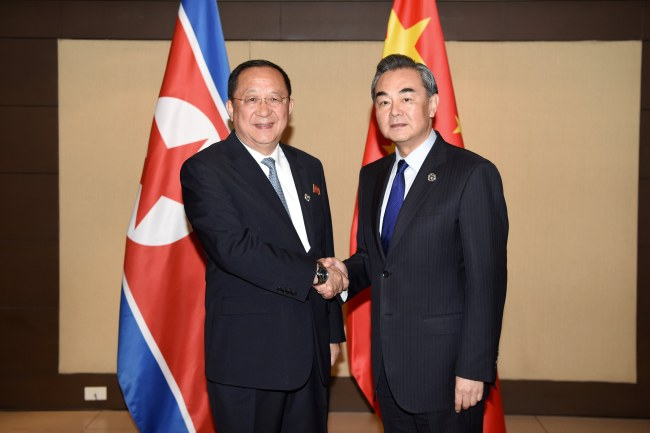 China's Foreign Minister Wang Yi (R) shakes hands with North Korea's Foreign Minister Ri Yong Ho (L) during their bilateral meeting on the sidelines of the Association of South East Asian Nations (ASEAN) Foreign Ministers' Meeting (AMM) and Related Meetings in Manila, Philippines, 06 August 2017. Top diplomats from 27 countries gather in Manila for the 50th Association of South East Asian Nations (ASEAN) Foreign Ministers' Meeting (AMM) and Related Meetings from 02 to 08 August with the theme 'Partnering for Change, Engaging the World', to promote unity with and among ASEAN member states and its global partners. The ASEAN meetings is expected to result in a joint communique that will address matters related to disputed islands in the South China Sea. (EPA/ROUELLE UMALI)