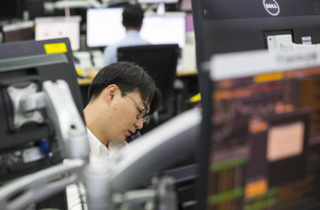 Korean shares end lower on foreign selling amid tensions over N. Korea