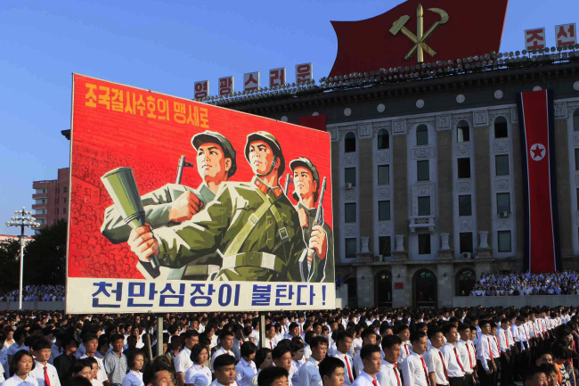 North Koreans stage a rally in Pyongyang on Thursday. (AP-Yonhap)
