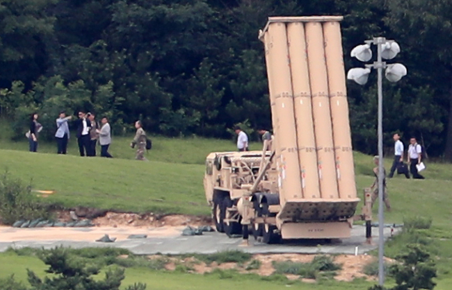 US military officers pass by the THAAD deployment site in Seongju, southeast South Korea on Saturday. (Yonhap)