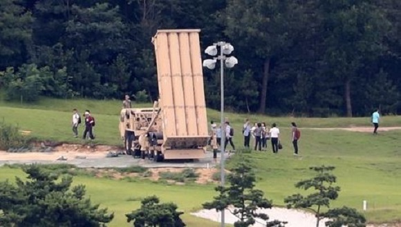 Officials from the defense and environment ministries conduct a joint environmental survey of electromagnetic radiation and noise of the Terminal High Altitude Area Defense system in Seongju, North Gyeongsang Province, on Aug. 12, 2017. (Yonhap)