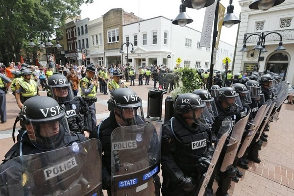 Virginia State Police cordon off an area around the site where a car ran into a group of protesters after a white nationalist rally in Charlottesville, VA (AP)