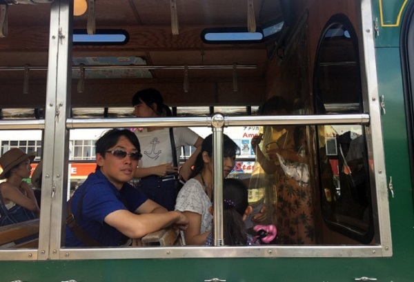Visitors sit on a tour bus in Tumon, Guam Monday, Aug. 14, 2017. Tourists haven`t been deterred from visiting the tropical island of Guam even though the US territory has been the target of threats from North Korea during a week of angry words exchanged by Pyongyang and Washington. (AP)