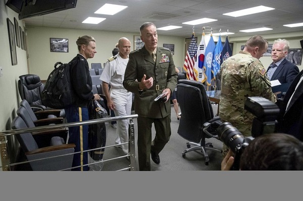 Joint Chief Chairman Gen. Joseph Dunford, center, departs following a news conference at US Army Garrison Yongsan, Seoul, South Korea, Monday, Aug. 14, 2017. The top US military officer told his counterparts in South Korea on Monday that the US is ready to use the