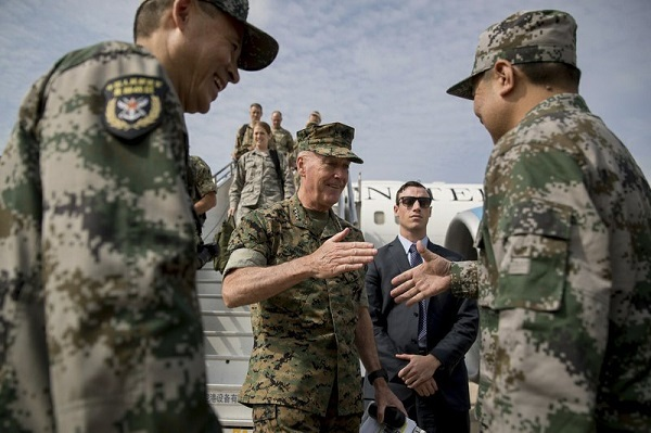 Joint Chiefs Chairman Gen. Joseph Dunford, center, is greeted by Chinese military officials as he arrives in Shenyang, China, Wednesday, Aug. 16, 2017, to observe a Chinese Military Exercise. (AP)