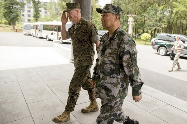 Joint Chiefs Chairman Gen. Joseph Dunford and Chinese Northern Theater Command Commander Gen. Song Puxuan, right, arrive for a meeting at Northern Theater Command Army Force Haichung Camp in Haichung, China, Wednesday, Aug. 16, 2017. (AP