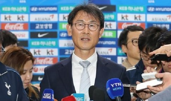 In this file photo taken on April 13, 2017, South Korea women`s football head coach Yoon Duk-yeo speaks to reporters at Gimpo International Airport in Seoul. (Yonhap)