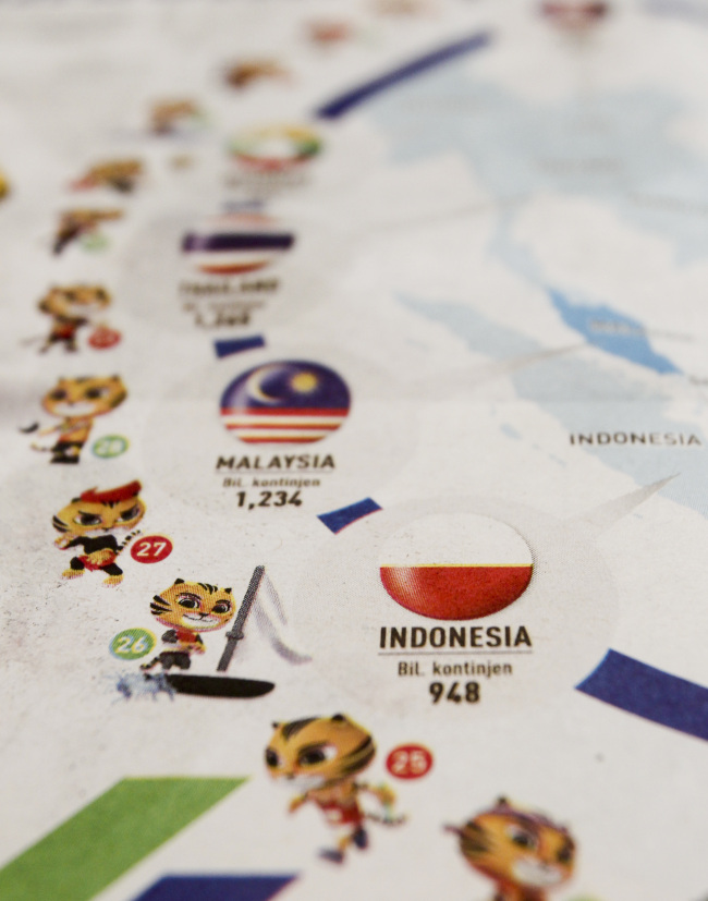 Indonesia's national flag, printed upside down on a local newspaper infographic chart for the 29th South East Asian Games, is seen in Kuala Lumpur, Malaysia Sunday, Aug. 20, 2017. (AP-Yonhap)