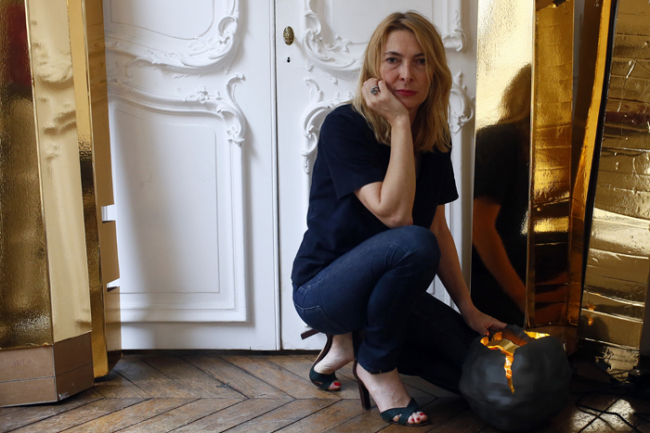 French lighting designer Odile Soudant poses next to her creations in her studio in Paris, Friday Aug. 18, 2017. (AP-Yonhap)