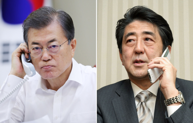 South Korean President Moon Jae-in (left) and Japanese Prime Minister Shinzo Abe (Yonhap)