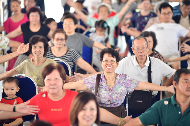 Senior Singaporeans take part in an exercise for lifelong health, part of the government's preventative health care. (Ministry of Health)