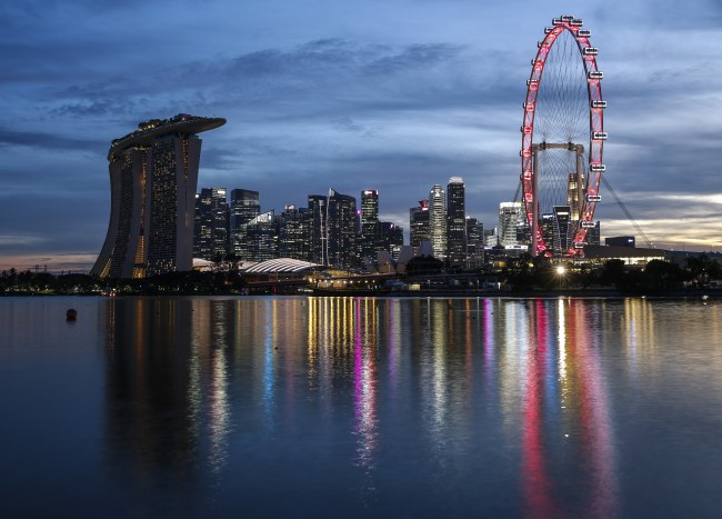 The Marina Bay Sands hotel, the financial district and the Singapore Flyer seen at dusk in Singapore on Aug. 9, the country's National Day marking its separation from the Federation of Malaysia in 1965. (EPA/WALLACE WOON)