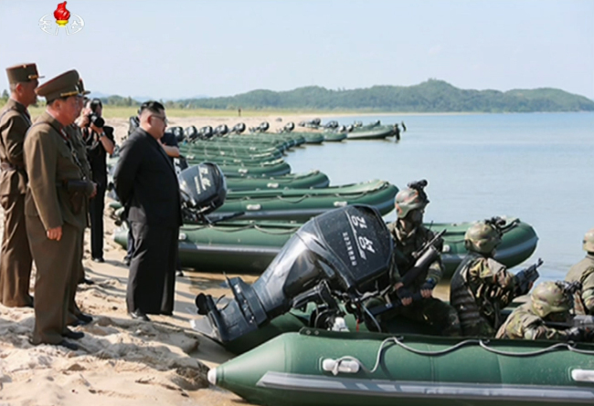 The image captured from the official Korean Central Television shows North Korean leader Kim Jong-un (center) overseeing a drill of special forces units, designed to seize Baengnyeongdo and Yeonpyeongdo, two of the five major South Korean islands near the inter-Korean border in the West Sea. (Yonhap)