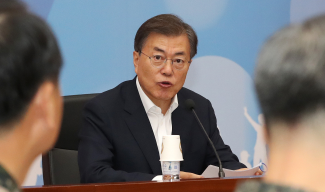 President Moon Jae-in speaks in front of the Ministry of National Defense and Ministry of Veterans and Patriots Affairs (Yonhap)