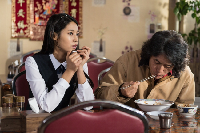 "From left: Seolhyun and Seol Kyung-gu star in ""Memoirs of a Murderer"" (Showbox)"