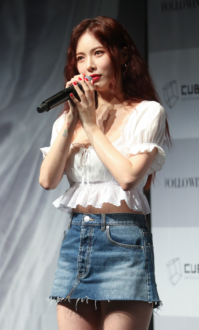 HyunA speaks at a press conference held Tuesday in Seoul. (Yonhap)