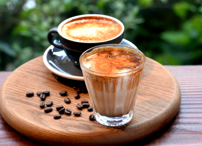 Dorrell's famous Nutty Cloud (front) -- a blend of house-made peanut cream, espresso and cold milk -- and its take on Einspanner (back) -- featuring a house-made cream concoction that fuses into a potent Americano (Photo credit: Park Hyun-koo/The Korea Herald)