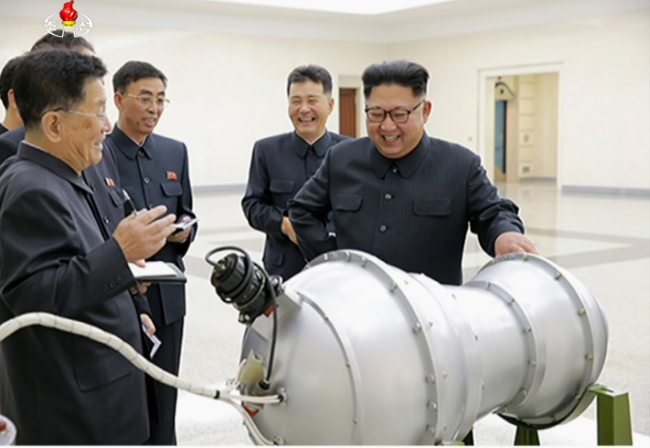 North Korean leader Kim Jong-un (far right) visits the Nuclear Weapons Institute on Sunday in Pyongyang. (Yonhap)