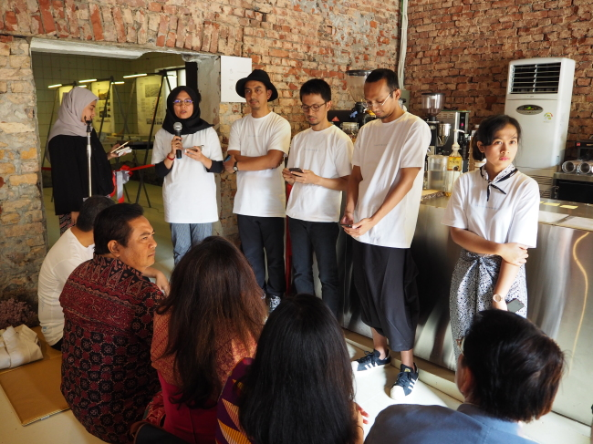 """Indonesian artists pose at the exhibition """"Architecture and the City: Indonesian architects and their responses, approaches and processes"""" at studio Haenghwatang in Seoul on Saturday. (Joel Lee/The Korea Herald)"""
