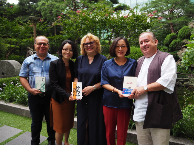 Winners of the LTI Korea Translation Award organized by the Literature Translation Institute of Korea pose at a press conference in Seoul on Tuesday. (Joel Lee/The Korea Herald)