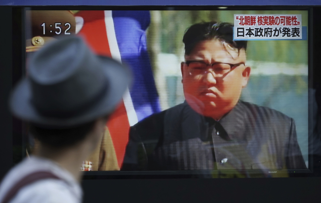 A man watches a TV news program on a public screen showing an image of North Korean leader Kim Jong Un while reporting North Korea`s possible nuclear test in Tokyo Sunday, Sept. 3, 2017. (AP-Yonhap)