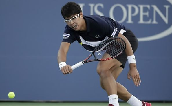In this photo taken by the Associated Press on Aug. 30, 2017, South Korean tennis player Chung Hyeon competes against John Isner of the United States during their second round men`s singles match at the US Open at Billie Jean King National Tennis Center in New York. (Yonhap)