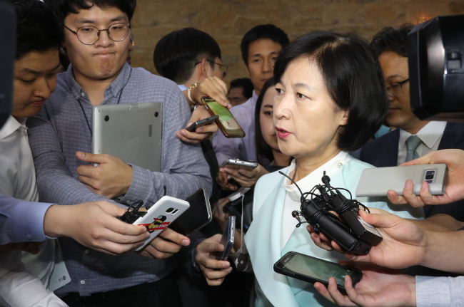 Rep. Choo Mi-ae, chairwoman of the ruling Democratic Party of Korea, is surrounded by journalists at the National Assembly in Seoul on Monday, after the parliament voted to reject the Constitutional Court president nominee Kim Yi-su. Yonhap