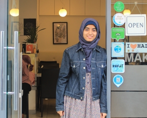 Safa Lamia Ahmed stands outside the restaurant she works at near the mosque in Itaewon. (Anita McKay/The Korea Herald)