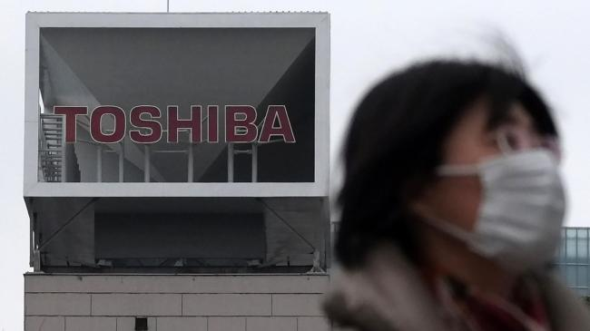 Toshiba sells chip unit for $18bn